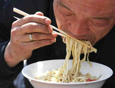 china slurping noodles small chopsticks people eating