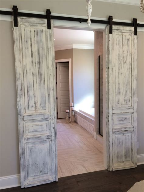 where to buy barn doors master bath entrance with our antique paneled doors whitewashed and hung barn door style