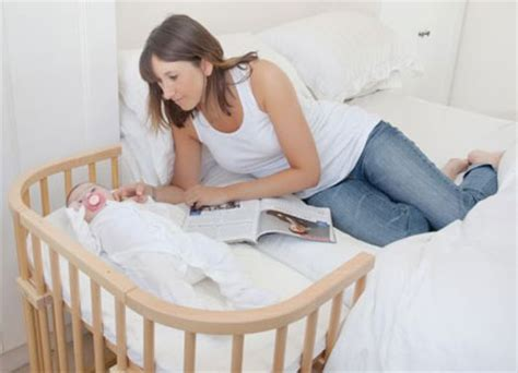 cribs that attach to side of bed home dzine bedrooms perfect cot for a new born