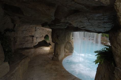 backyard cave cave grotto enclosed slide with waterfalls tropical