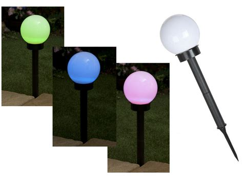 large colour changing solar globe light on stake garden