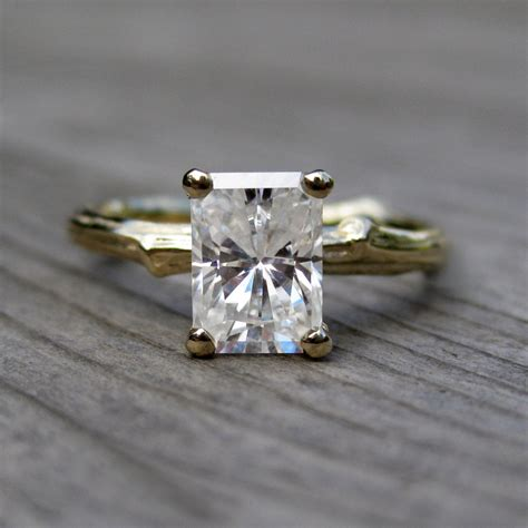 emerald cut engagement ring with moissanite onewed