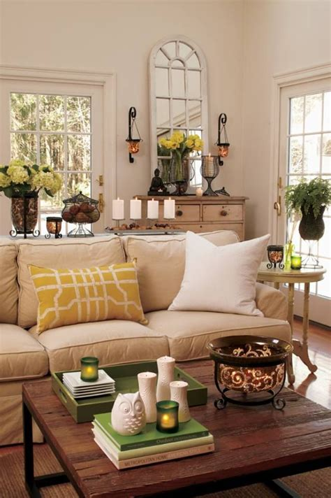 taupe sofa golden yellow pillow light walls black accents great room paint ideas