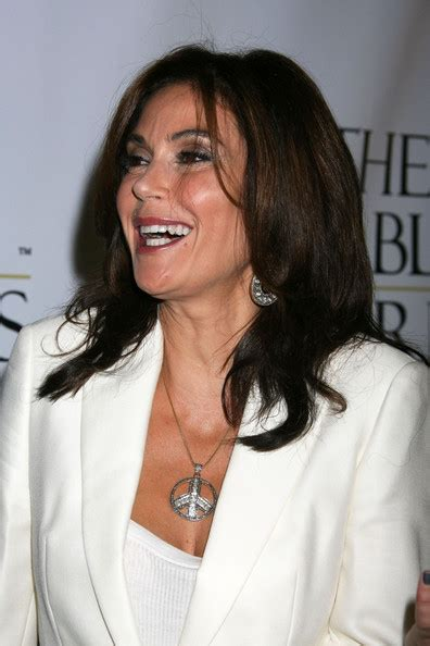 Get Look Teri Hatchers Swarovski Clutch From Clothes Our Back by Teri Hatcher Pendant Teri Hatcher Jewelry Looks