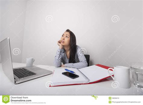 Sitting At Desk by Thoughtful Businesswoman Sitting At Desk In Office Stock Photography Image 38285612