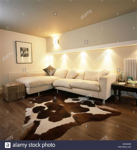 modern cowhide rug artificial cowhide rug in modern living room with