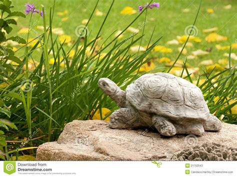 decorative turtle in a garden setting stock photos