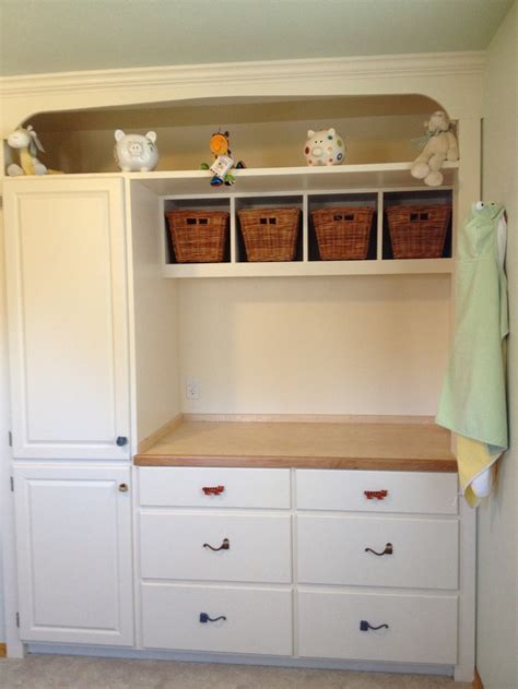 changing table with drawers and cabinet i tore out the closet and built in a changing table with