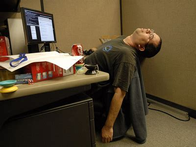 sleeping work cubicle stressed office local seo guide