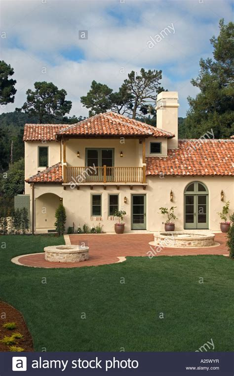luxury spanish style homes exterior of a spanish style luxury home with stucco walls