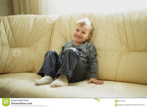boy on couch little boy sitting on couch stock photo image 58127087