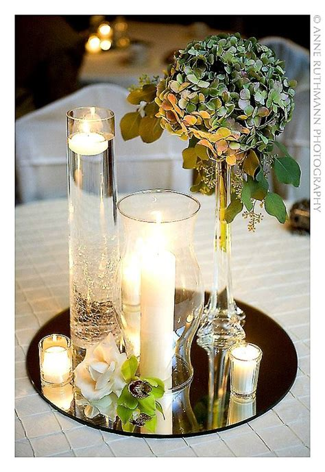 tall clear glass with tea lights floating other candle