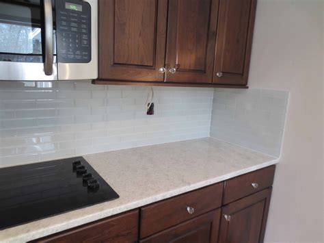 interior faux kitchen countertops with glass tile subway