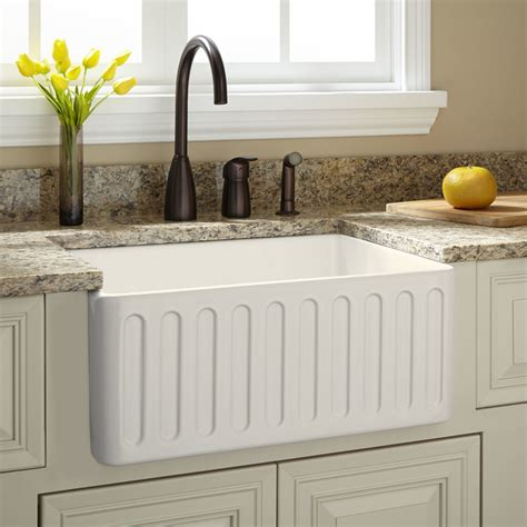 traditional kitchen sinks 24 quot northing fireclay farmhouse sink biscuit