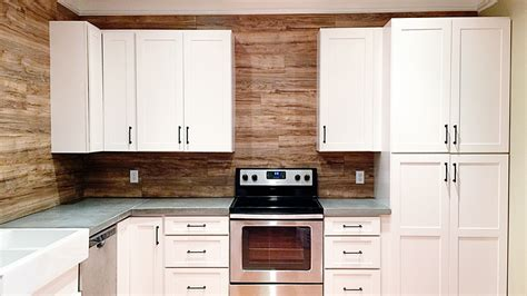 laminate kitchen backsplash use laminate flooring as a durable easy to clean backsplash in your kitchen lifehacker australia