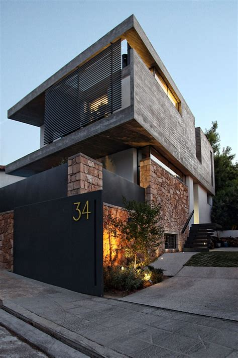 modern architecture home playful mix of textures driving energy inside modern greek