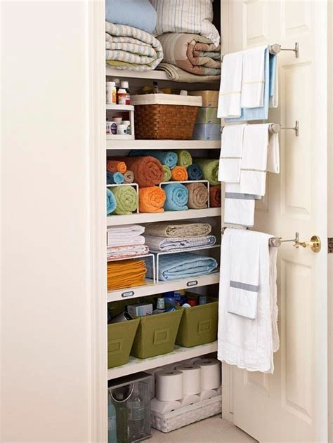 Organizing Towels In Closet by