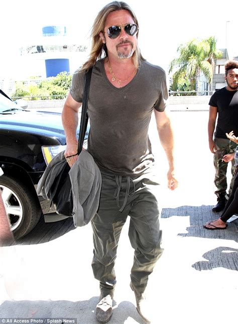 Brad Pitt shows off his toned torso through a tight nearly