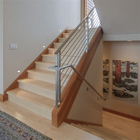 contemporary banister warm woods