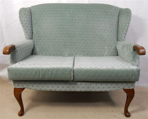 wingback settee sold upholstered two seater wingback fireside sofa settee