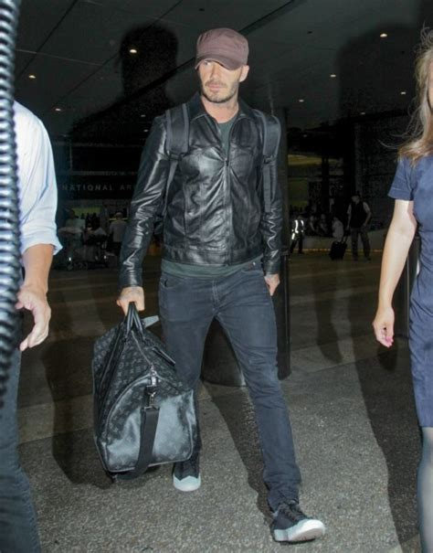 Louis Vuitton David Beckham With His Louis Vuitton Sac Squash And Pegase Luggage by David Beckham Spotted In Ben Sherman Laurent