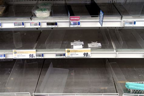 Tofu Shelf by Earthquake Empty Shelves At Local Supermarket In Tokyo
