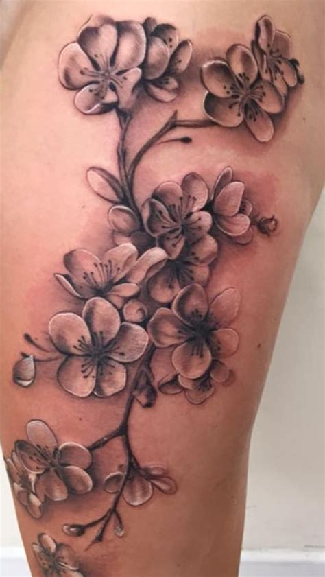 my cherry blossom tattoo in black and grey on my left