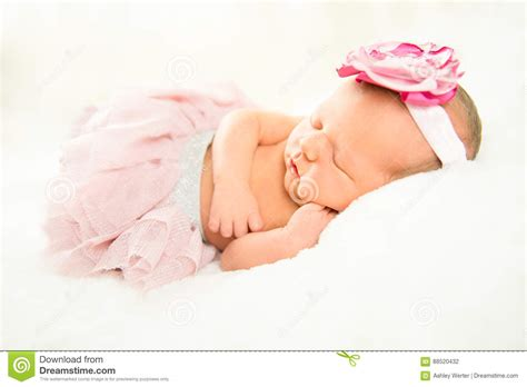 beautiful baby with flower headband stock image image newborn baby with light pink flower headband royalty