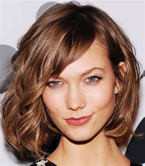 short and carefree with full bangs haircut for women brown medium length hair with bangs hair world magazine