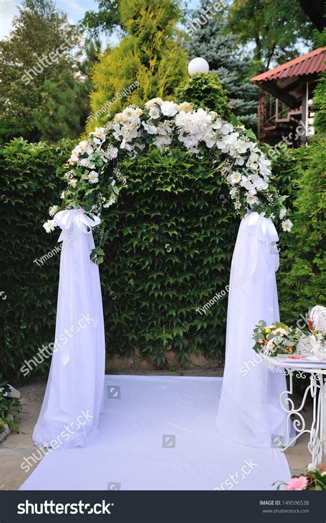 wedding arch white flowers stock photo
