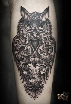 owl tattoo on leg calf by alex gallo cool bio mechanical owl tattoo with a little mouse