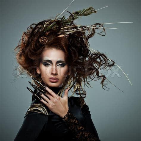 high fashion model  black dress  long nails