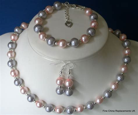 Handmade Jewelry Uk - two tone glass faux pearl necklace earrings and charm