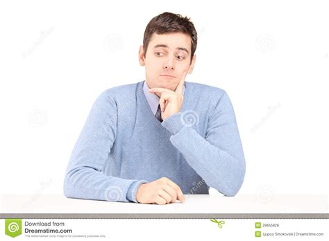 Man Sitting At A Desk Worried Young Man Sitting At A Desk Royalty Free Stock