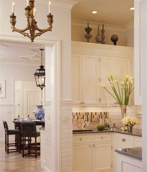 wall color same as mine cabinets white sub way white tiles and counters could try