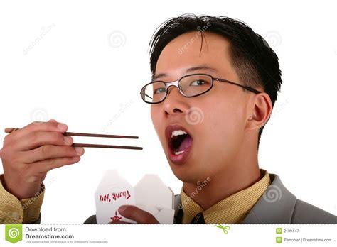 biz man eating  chopstick stock image image