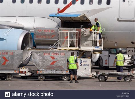 commercial air freight transport loading cargo on board an austrian stock photo 19503028 alamy