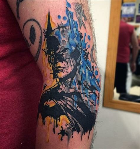 Batman Elbow Tattoo | abstract style colored elbow tattoo of batman