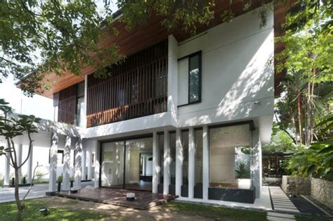 green home in malaysia built around mango trees hijauan