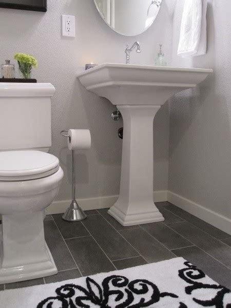 dark floor bathroom white bath dark floor