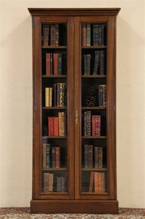 oak vintage bookcase or display cabinet glass