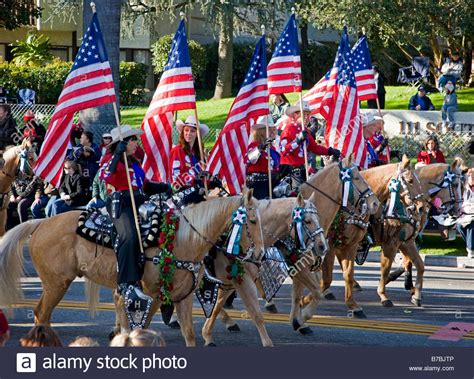 what do american in california rose for new year horseback riders with american flags in the annual new years day stock photo royalty free