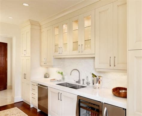 glass front kitchen cabinets transitional kitchen kvanum transitional kitchen wine coolers and ivory cabinets on