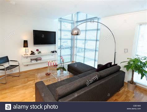 view of floor l over black sofa set with flat screen tv at modern stock photo royalty free