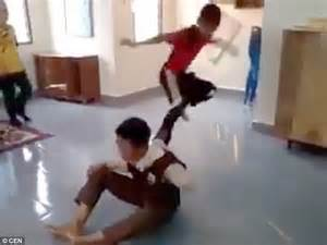 bully gets beat up by victim in locker room shows malaysian pupils beating up boy in school s islamic prayer room daily mail