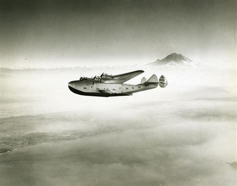 flying boat mount boeing 314 clipper with mt rainier in the background