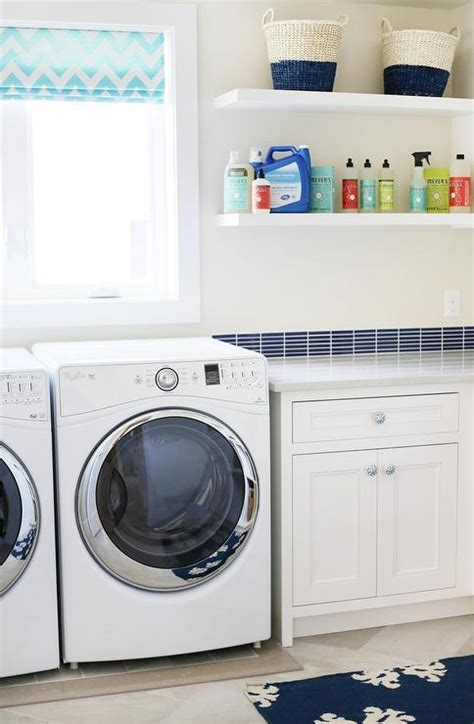 blue laundry room white and blue laundry room with cubbies filled with baskets contemporary laundry room