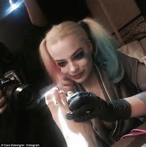 did margot robbie tattoo her suicide squad director on cara delevingne is latest member of suicide squad to get