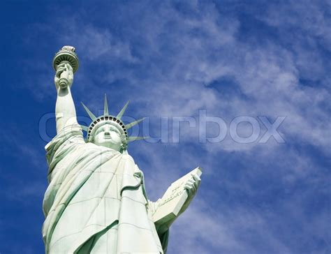 liberty out of a clear blue sky books statue of liberty isolated on blue sky background stock