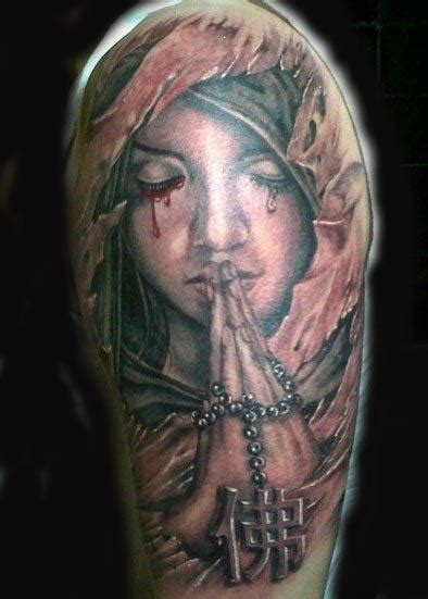 kneeling angel tattoo praying by visiting artist alink kootaishi tattoonow